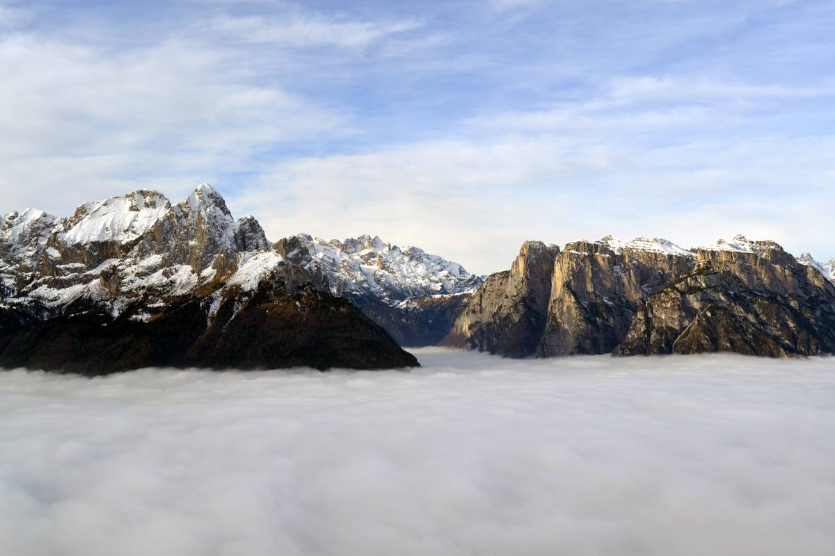 Slithering clouds through the San Lucano Valley help us imagine the glaciers' origin when the ice-contact lake in Pont was formed (photo Corrado Cattadori).